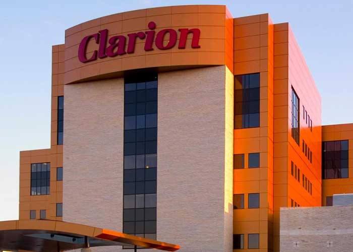 Clarion Hotel & Suites exterior at sunset
